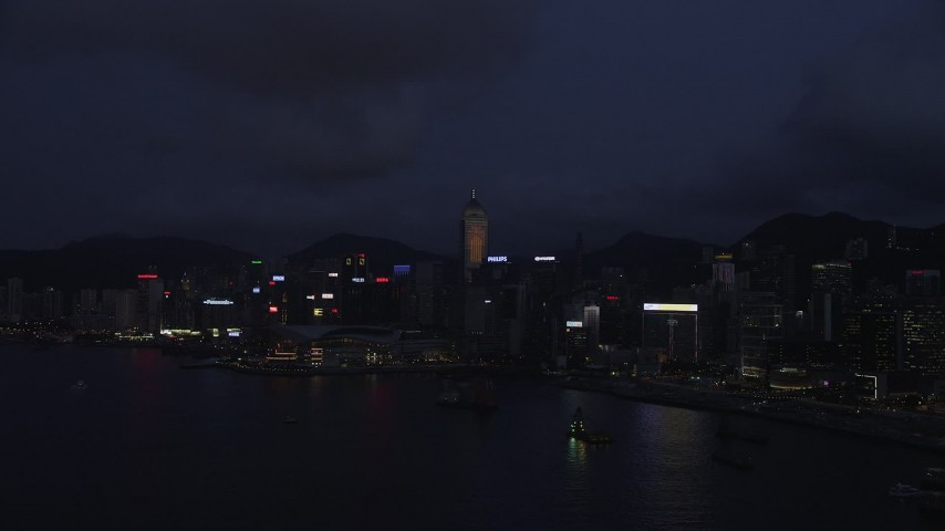 Approach Hong Kong Island Skyscrapers and Convention Center at Night Aerial Stock Footage   SS01_0132