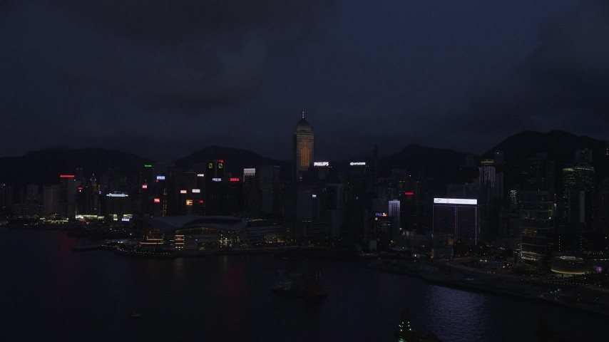 5K stock footage aerial video approach Hong Kong Island skyscrapers and convention center at night, China Aerial Stock Footage | SS01_0132