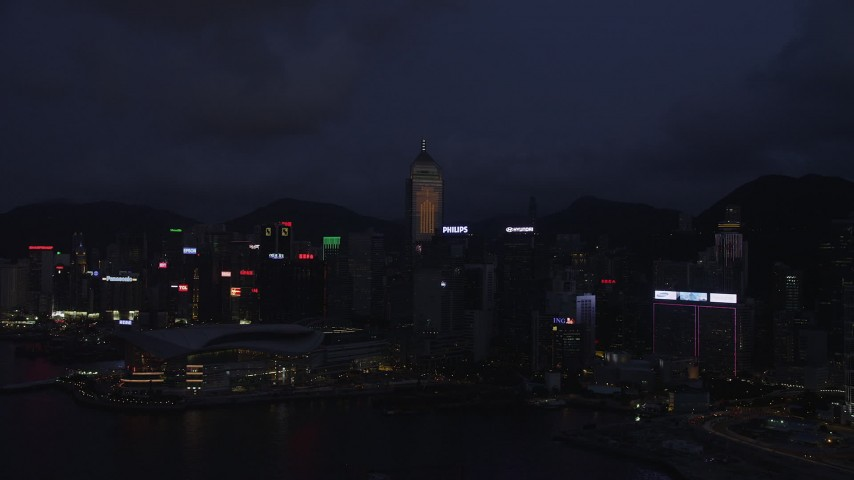5K stock footage aerial video approach skyscrapers and convention center on Hong Kong Island at night, China Aerial Stock Footage | SS01_0133
