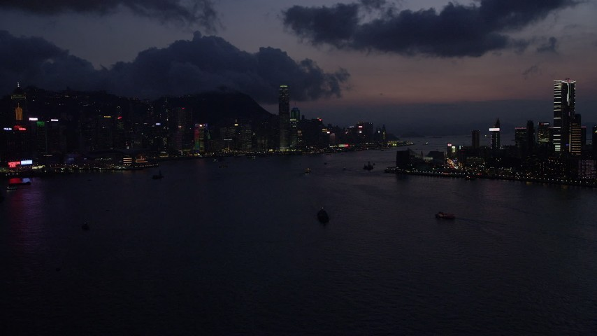 Hong Kong Island Skyline and Victoria Harbor at Night Aerial Stock Footage | SS01_0139