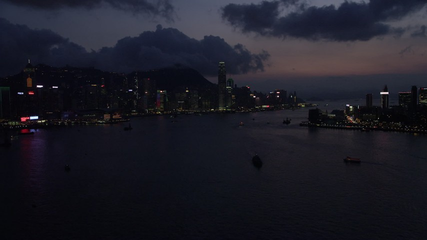 5K stock footage aerial video of Hong Kong Island skyline and Victoria Harbor at night, China Aerial Stock Footage | SS01_0139