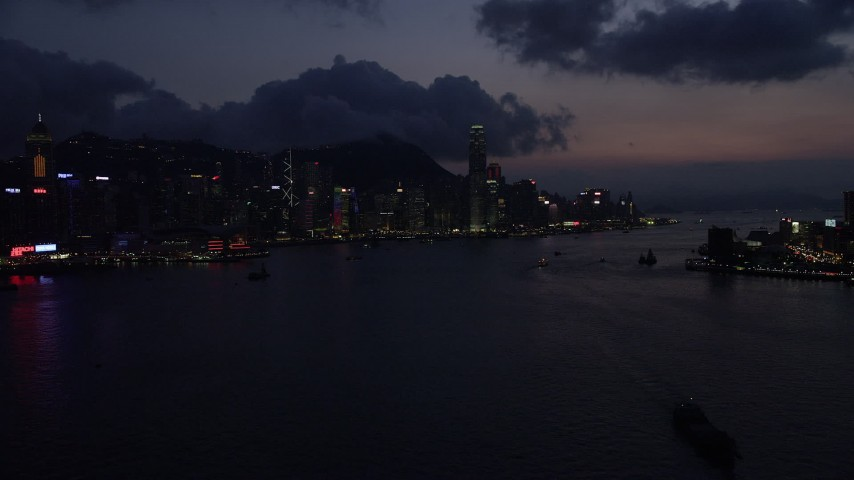 5K stock footage aerial video of approaching Hong Kong Island and Victoria Harbor at nighttime, China Aerial Stock Footage | SS01_0140