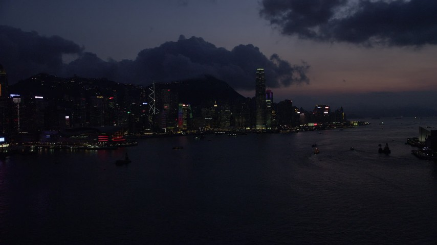 5K stock footage aerial video skyline of Hong Kong Island, Victoria Harbor at nighttime in China Aerial Stock Footage | SS01_0141