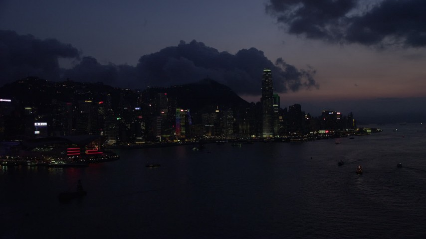 5K stock footage aerial video waterfront skyline of Hong Kong Island and Victoria Harbor at night, China Aerial Stock Footage | SS01_0142