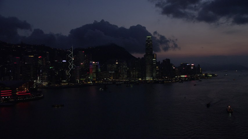 Approaching the Hong Kong Island Skyline from Victoria Harbor at Night Aerial Stock Footage | SS01_0143