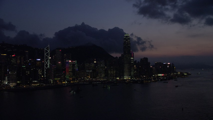 Hong Kong Island Skyline seen from Victoria Harbor at Nighttime Aerial Stock Footage   SS01_0144