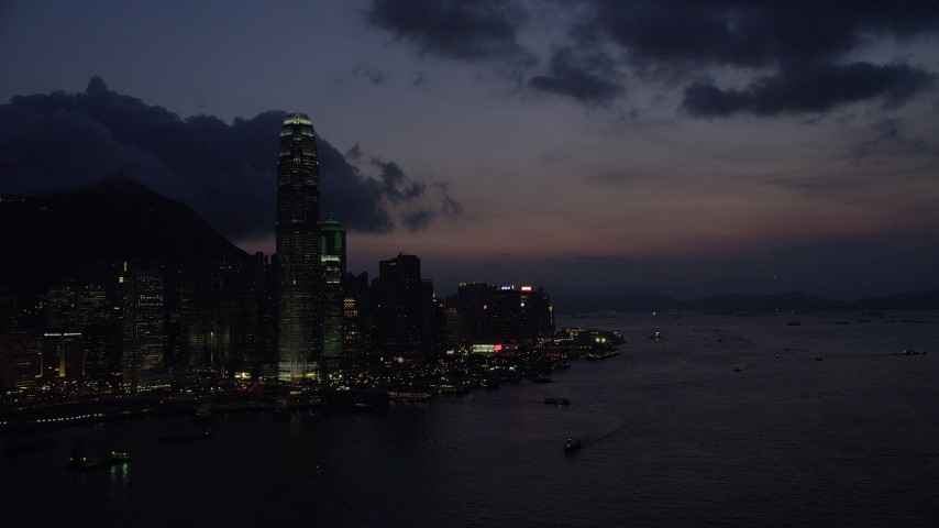 5K stock footage aerial video pan across the Hong Kong Island skyline and approach the shore at night in China Aerial Stock Footage | SS01_0145