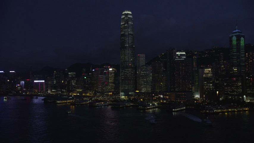 5K stock footage aerial video approach International Finance Centre and piers on Hong Kong Island at night, China Aerial Stock Footage | SS01_0147