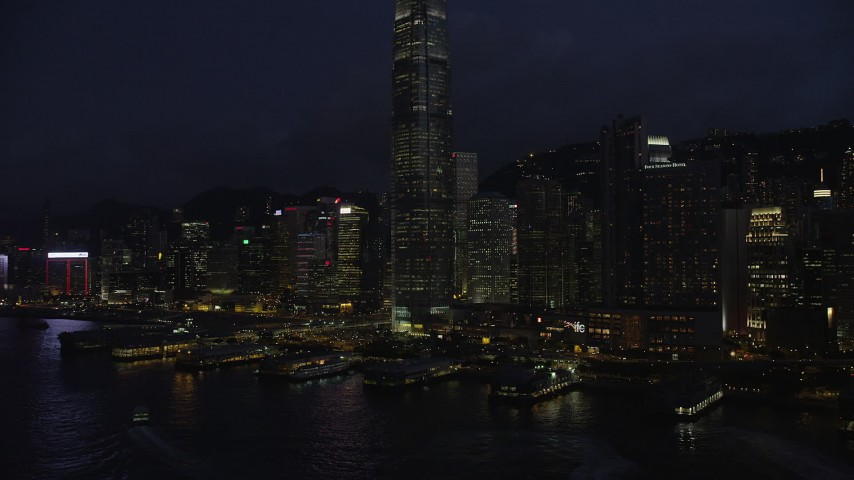 Approach Piers on Hong Kong Island near Skyscrapers at Night Aerial Stock Footage | SS01_0148