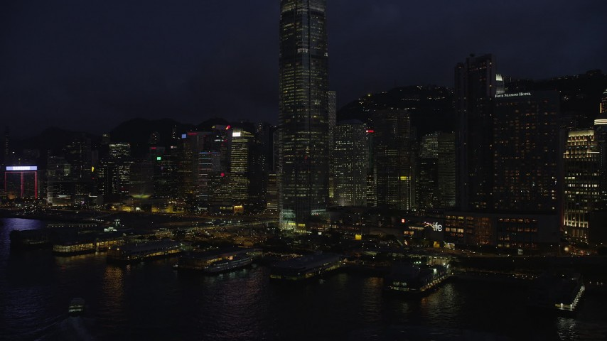 5K stock footage aerial video approach piers on Hong Kong Island near skyscrapers at night in China Aerial Stock Footage | SS01_0148
