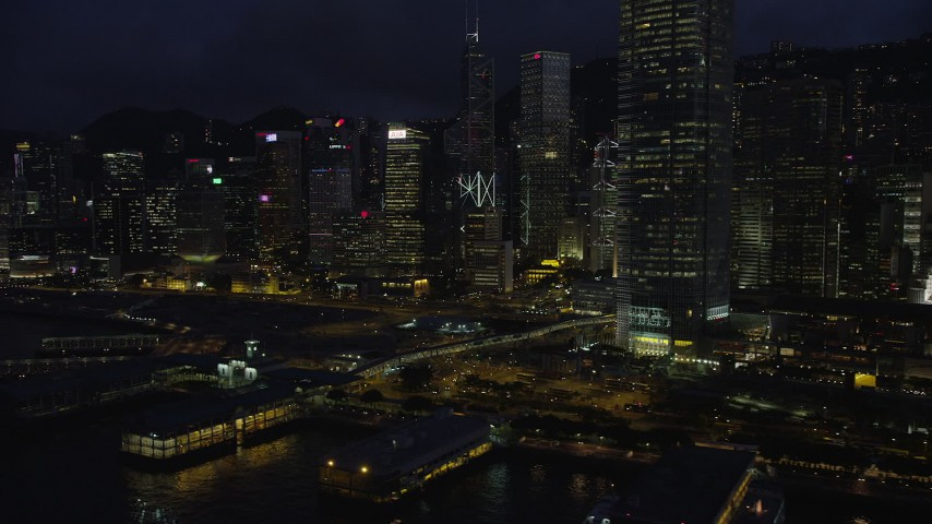 5K stock footage aerial video flyby piers and skyscrapers on Hong Kong Island at night, China Aerial Stock Footage | SS01_0149