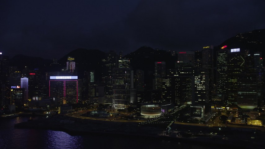 5K stock footage video flyby skyscrapers by the harbor on Hong Kong Island at night, China Aerial Stock Footage | SS01_0151