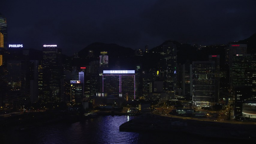Flyby Central Plaza and High-Rises on Hong Kong Island at Night Aerial Stock Footage | SS01_0152