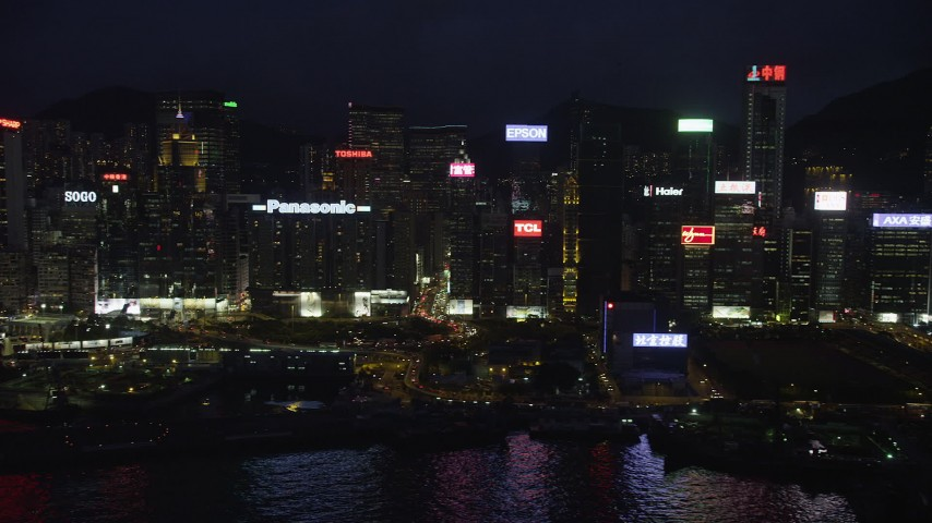 5K stock footage aerial video of high-rises and office buildings lining the harbor on Hong Kong Island at nighttime, China Aerial Stock Footage | SS01_0154