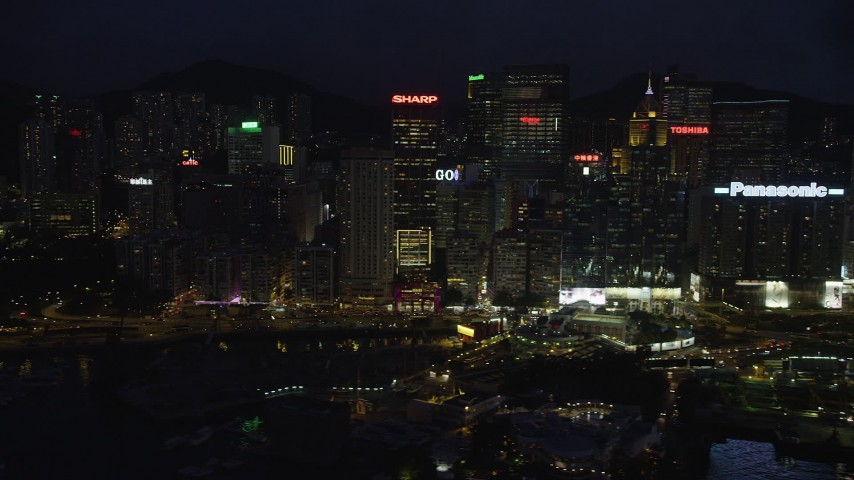 5K stock footage aerial video of waterfront high-rises and office buildings at night on Hong Kong Island, China Aerial Stock Footage | SS01_0155
