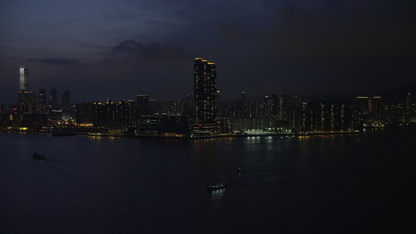 5K stock footage aerial video approach Harbourfront Landmark skyscrapers in Kowloon, Hong Kong at night, China Aerial Stock Footage | SS01_0156