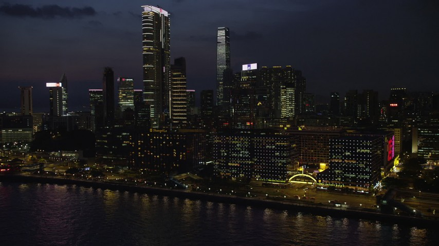 5K stock footage aerial video of hotel overlooking the harbor near The Masterpiece at night in Kowloon, Hong Kong, China Aerial Stock Footage   SS01_0163