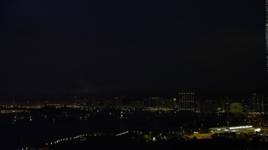 5K stock footage aerial video flash of lightning over distant Kowloon apartment buildings at night in Hong Kong, China Aerial Stock Footage | SS01_0164