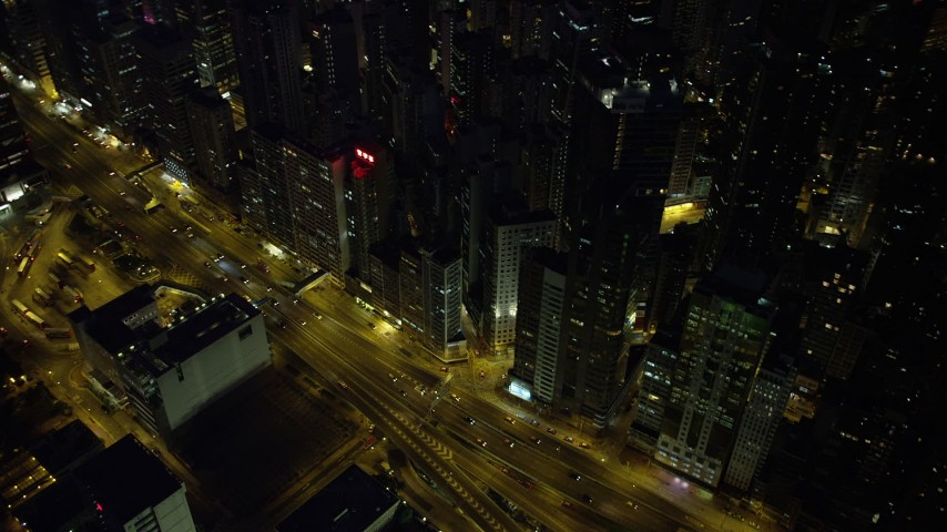5K stock footage aerial video bird's eye view of busy street and office buildings at night on Hong Kong Island, China Aerial Stock Footage | SS01_0167