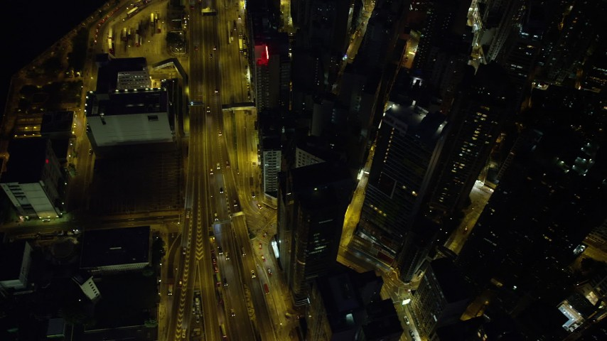 5K stock footage aerial video bird's eye view of a busy street and office towers at night in Hong Kong Island, China Aerial Stock Footage | SS01_0168
