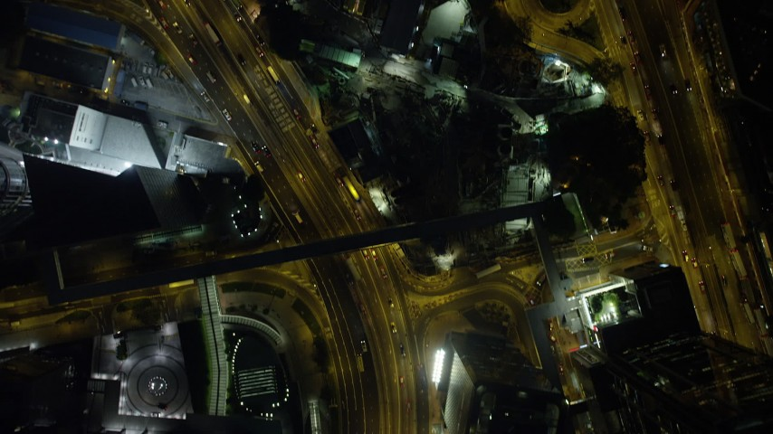 Busy City Streets and Tall Skyscrapers at Night on Hong Kong Island Aerial Stock Footage | SS01_0173