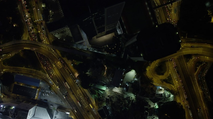5K stock footage aerial video of busy city streets and tall skyscrapers at night on Hong Kong Island, China Aerial Stock Footage | SS01_0173