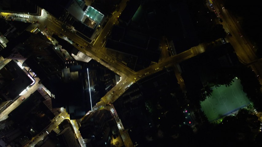 5K stock footage aerial video of a bird's eye view of heavy traffic on city streets at night on Hong Kong Island, China Aerial Stock Footage | SS01_0176