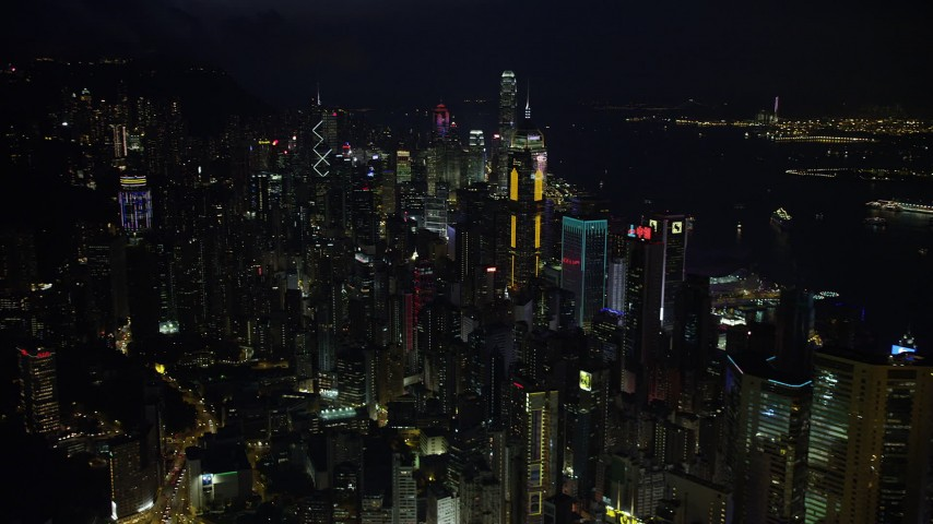 5K stock footage aerial video approach and pan across tall towers of Hong Kong Island at night, China Aerial Stock Footage | SS01_0177