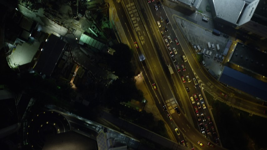 5K stock footage aerial video bird's eye of heavy traffic moving through Hong Kong Island at night, China Aerial Stock Footage | SS01_0179