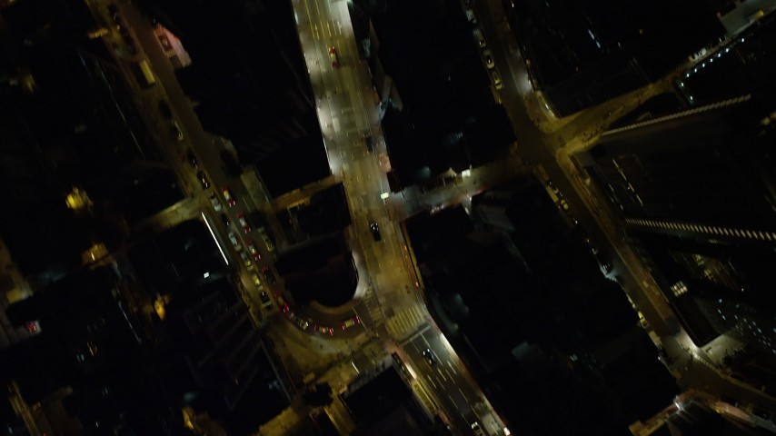 5K stock footage aerial video a bird's eye of wide and narrow streets through the city at night on Hong Kong Island, China Aerial Stock Footage | SS01_0184