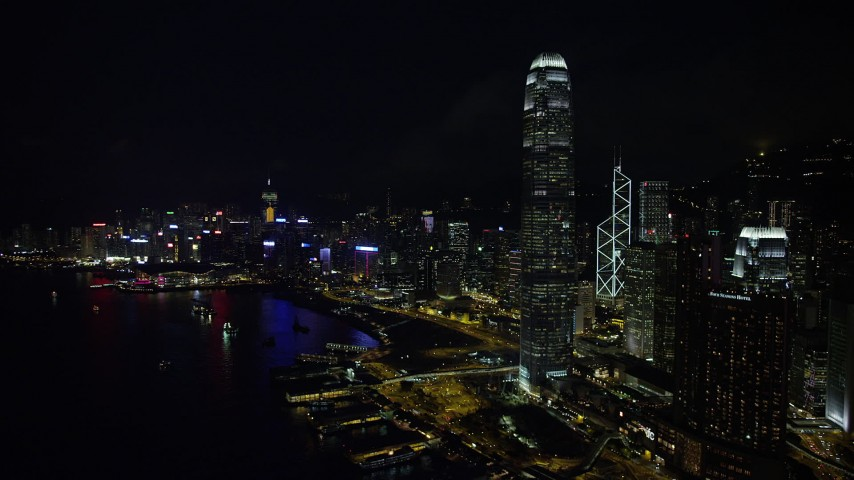 5K stock footage aerial video of International Finance Centre and skyscrapers on Hong Kong Island at night, China Aerial Stock Footage | SS01_0185