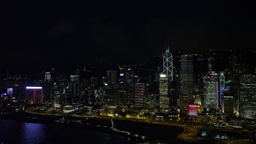 5K stock footage aerial video of tall skyscrapers beside the harbor at night on Hong Kong Island, China Aerial Stock Footage | SS01_0187