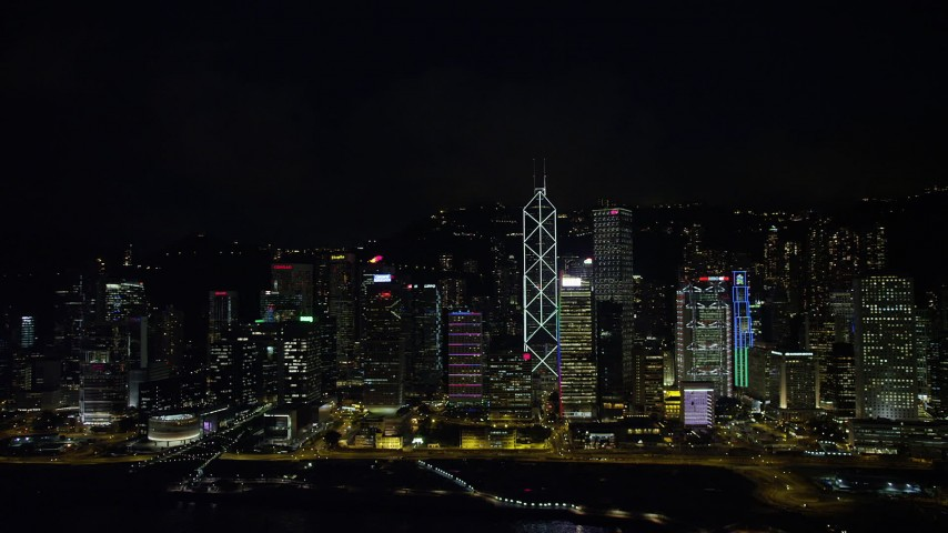 Tall Hong Kong Island Skyscrapers seen from Victoria Harbor at Nighttime Aerial Stock Footage | SS01_0188