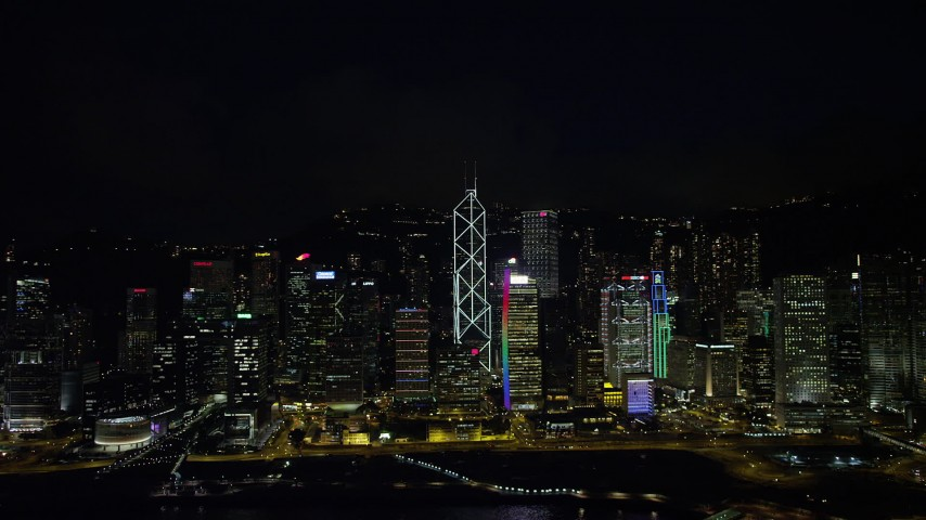 5K stock footage aerial video of tall Hong Kong Island skyscrapers seen from Victoria Harbor at nighttime, China Aerial Stock Footage | SS01_0188