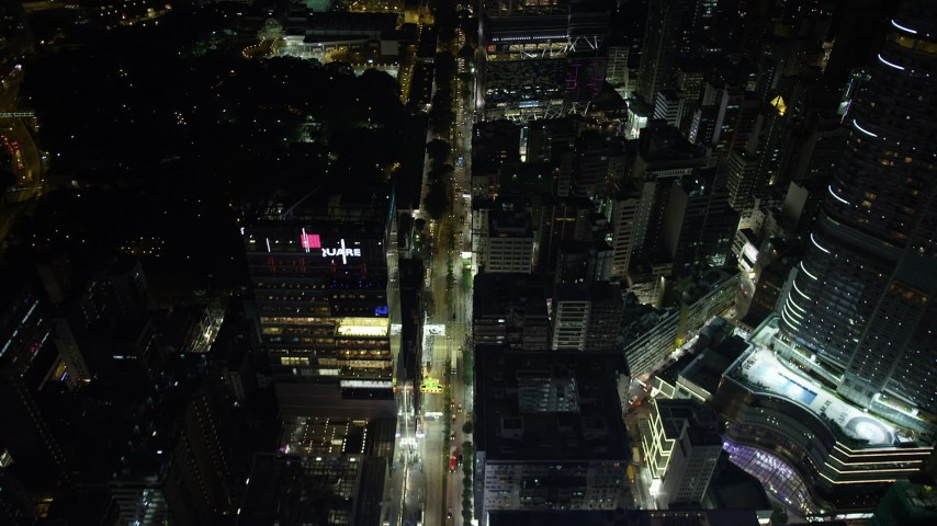 5K stock footage aerial video fly over Nathan Road through Kowloon at night in Hong Kong, China Aerial Stock Footage | SS01_0192