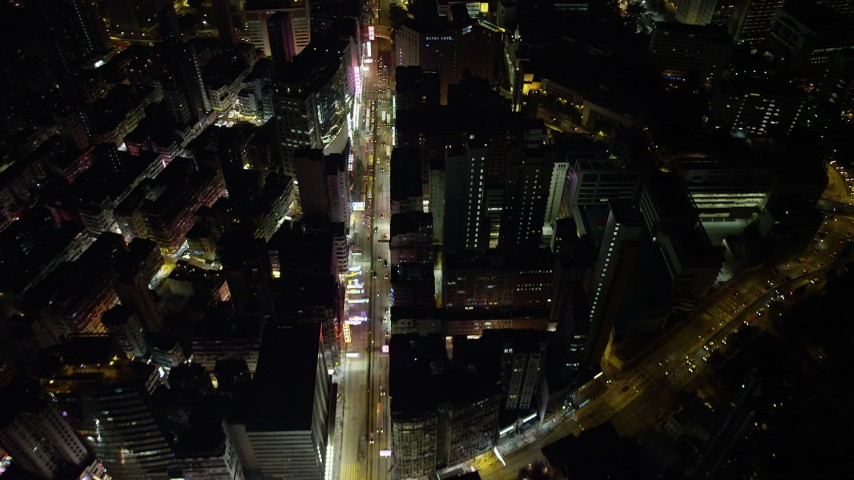 5K stock footage aerial video of following Nathan Road past office buildings at night in Kowloon, Hong Kong, China Aerial Stock Footage | SS01_0195