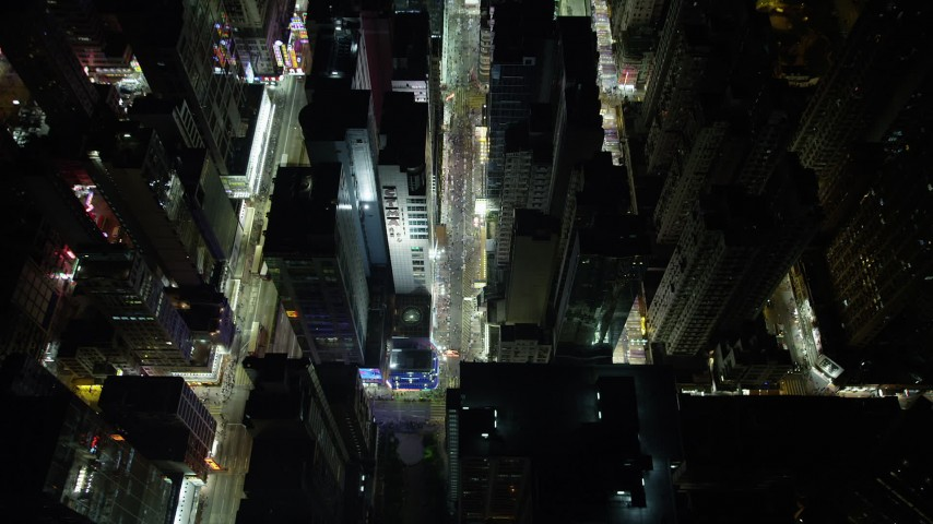 5K stock footage aerial video approach and tilt to bird's eye of city streets and a marketplace at night in Kowloon, Hong Kong, China Aerial Stock Footage | SS01_0198