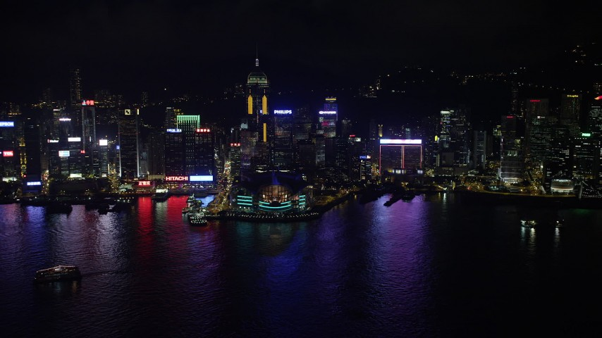 5K stock footage aerial video approach convention center and Central Plaza high-rise at night on Hong Kong Island, China Aerial Stock Footage | SS01_0202