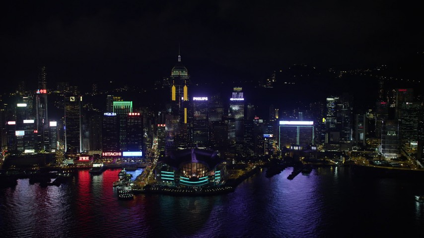 Approaching Convention Center and Central Plaza from Harbor at Night on Hong Kong Island Aerial Stock Footage   SS01_0203