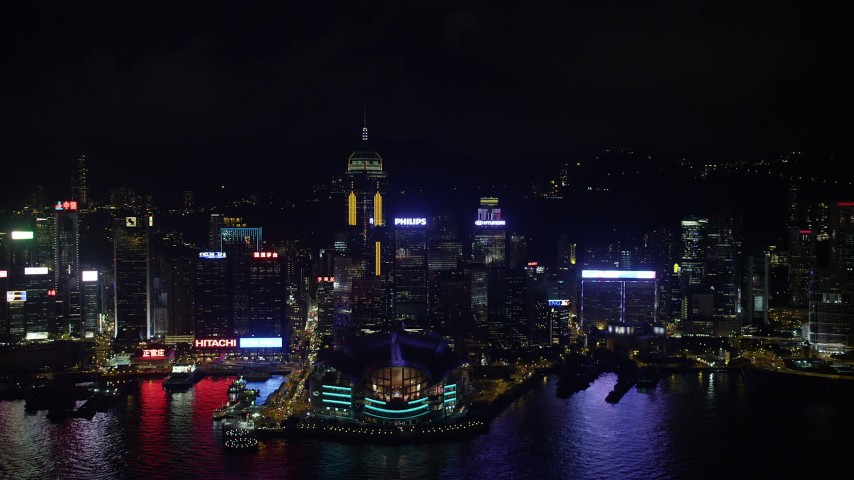 5K stock footage aerial video of approaching convention center and Central Plaza from harbor at night on Hong Kong Island, China Aerial Stock Footage | SS01_0203
