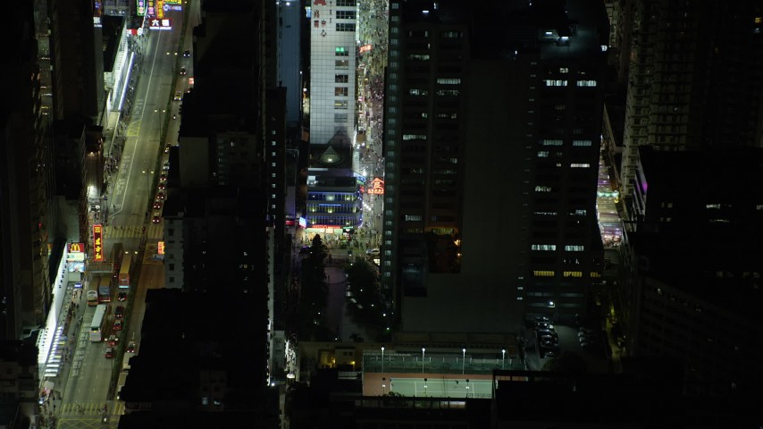 5K stock footage aerial video approach and tilt to a corner shop at night in Kowloon, Hong Kong, China Aerial Stock Footage | SS01_0206