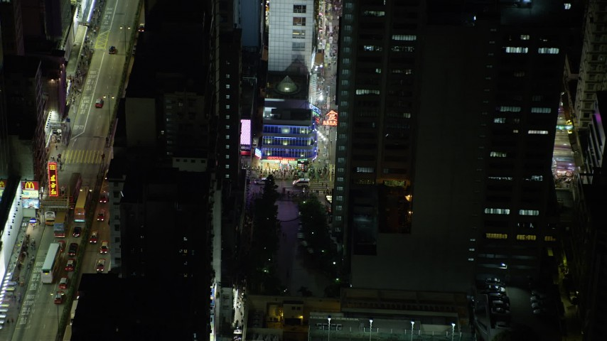 5K stock footage aerial video of a slow approach to corner shop at night in Kowloon, Hong Kong, China Aerial Stock Footage | SS01_0207