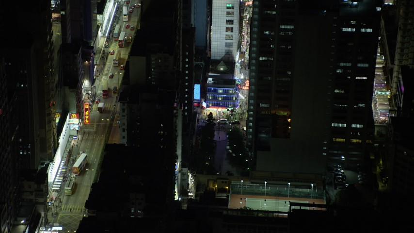 5K stock footage aerial video of slowly flying away from corner shop at night in Kowloon, Hong Kong, China Aerial Stock Footage | SS01_0211
