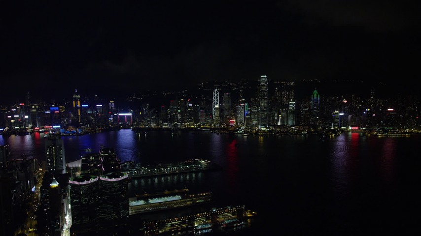 Approach Hong Kong Island Skyline from Kowloon Piers at Night Aerial Stock Footage | SS01_0215