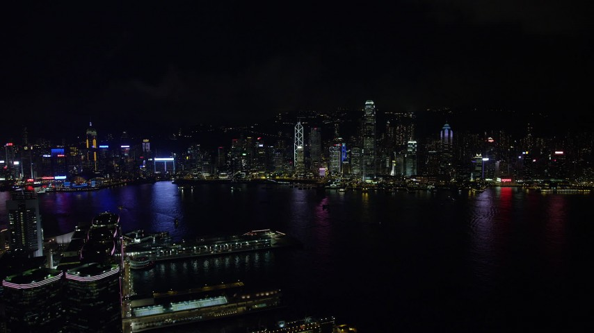 5K stock footage aerial video approach Hong Kong Island skyline from Kowloon piers at night, China Aerial Stock Footage | SS01_0215