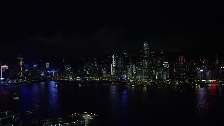 5K stock footage aerial video approach Hong Kong Island skyline from Kowloon at night, China Aerial Stock Footage | SS01_0216
