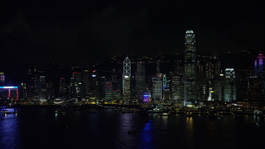 Approach Hong Kong Island Skyscrapers across Victoria Harbor at Night Aerial Stock Footage   SS01_0217