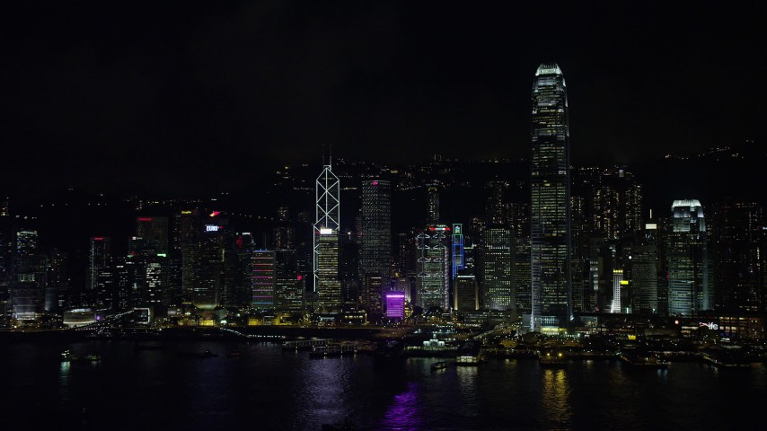 5K stock footage aerial video approach Hong Kong Island skyscrapers across Victoria Harbor at night, China Aerial Stock Footage | SS01_0217