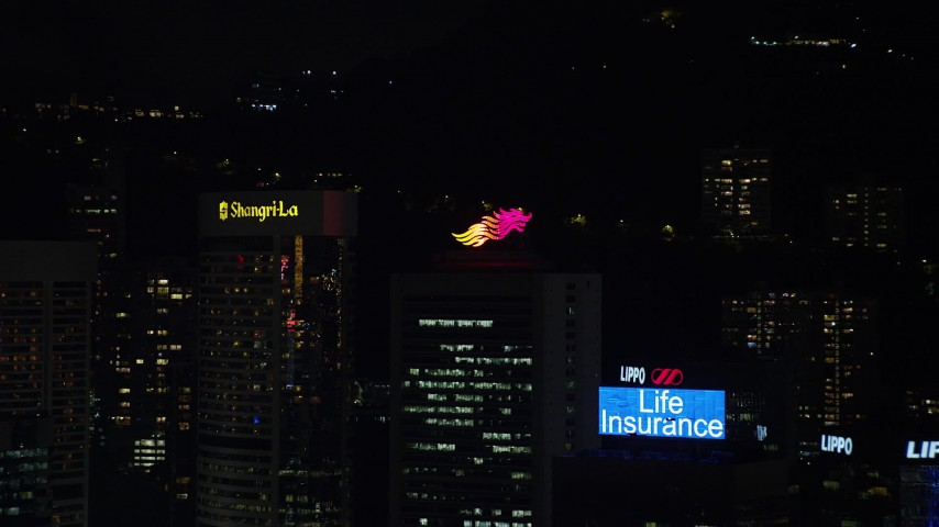 5K stock footage aerial video approach high-rise rooftops with billboards at night on Hong Kong Island, China Aerial Stock Footage | SS01_0220