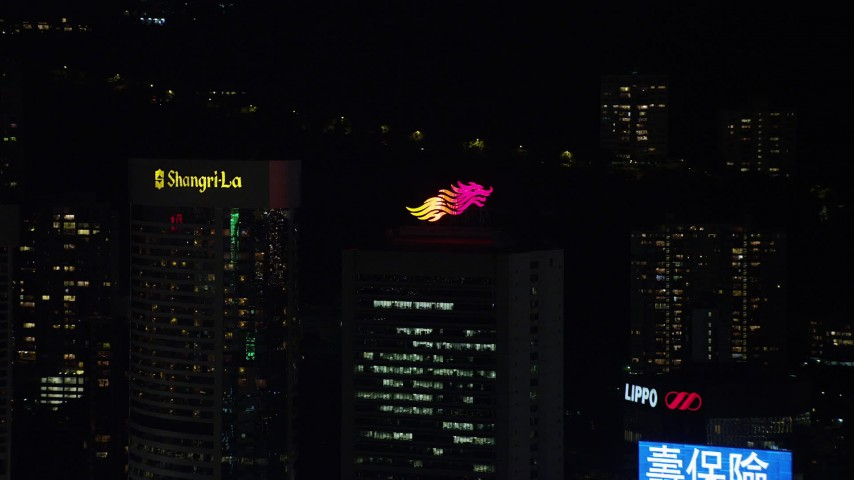 Approach Product Logo on Hong Kong Island High-rise Rooftop at Night Aerial Stock Footage | SS01_0221